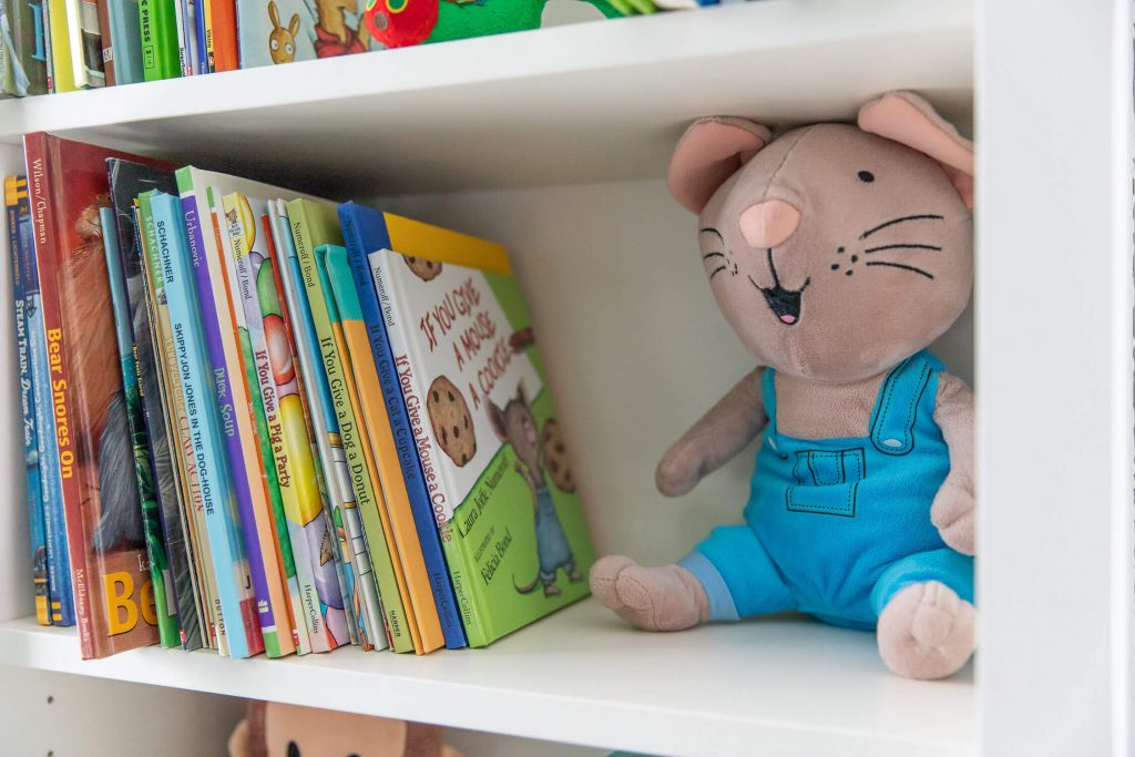 Close up of bookshelf showing Laura Numeroff books and a Mouse stuffed animal
