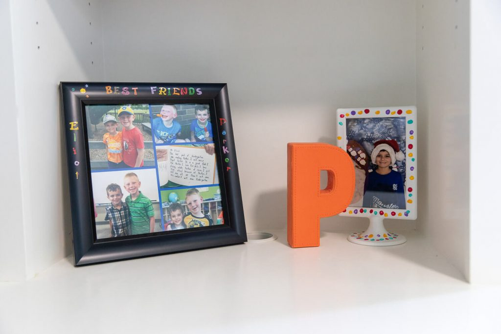 close up of photos on built in shelves